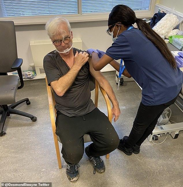 Sir Desmond Swayne, 64, has posted a picture on Twitter of him receiving a Covid vaccination.