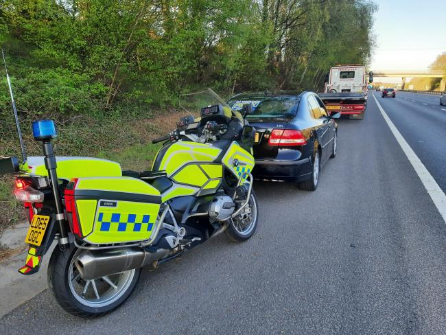 Saab stopped on the M27 near Cadnam. Photo from: Hampshire Roads Policing Unit/Twitter.