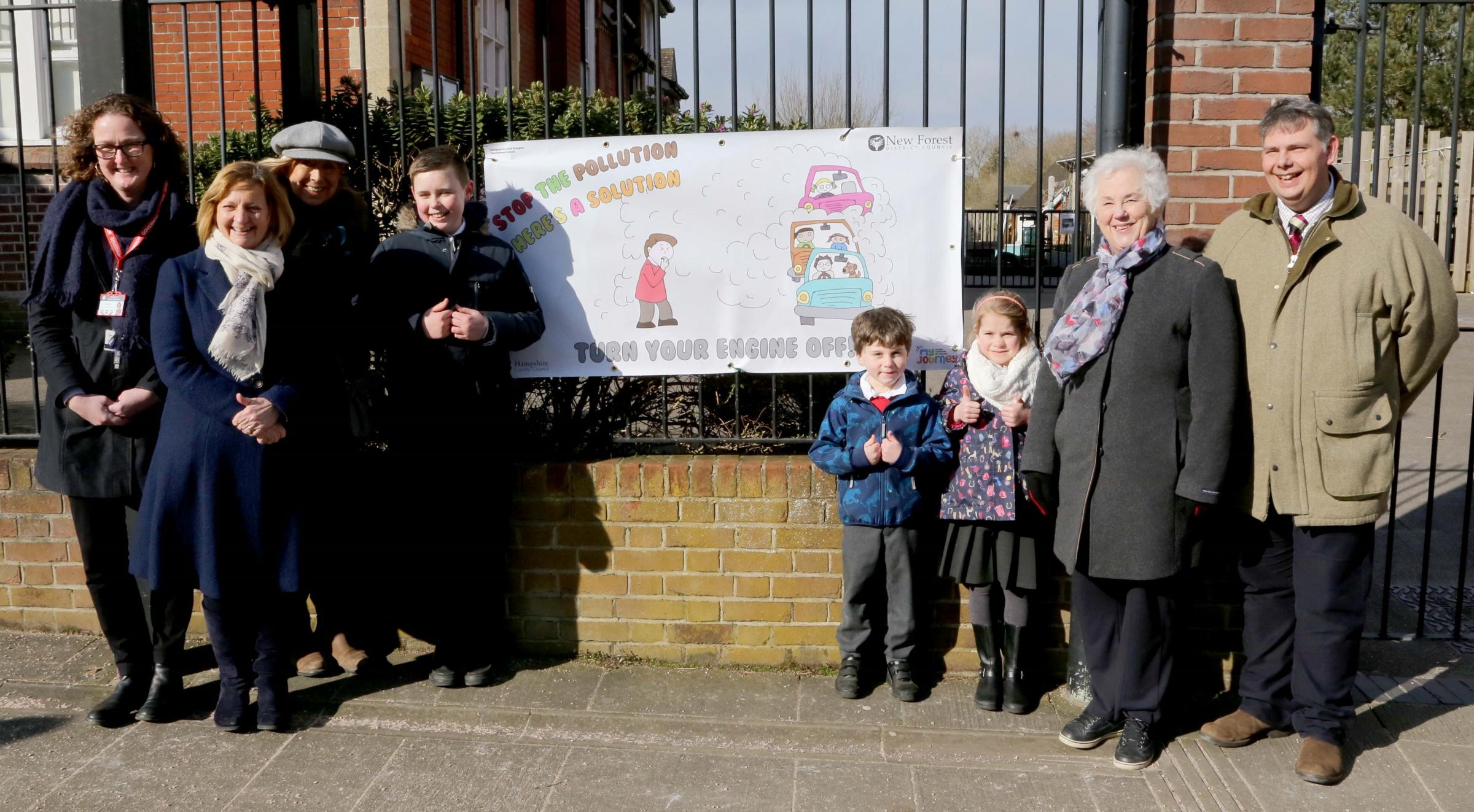 Pictured, from left, are Marie Kirk, chair of governors at St Michaels and All Angels Infant School, Tina Daniels, the school's executive head, Cllr Alison Hoare, Jack Sturgess, who designed the banner, school pupils, Cllr Pat Wyeth and Cllr Edward He
