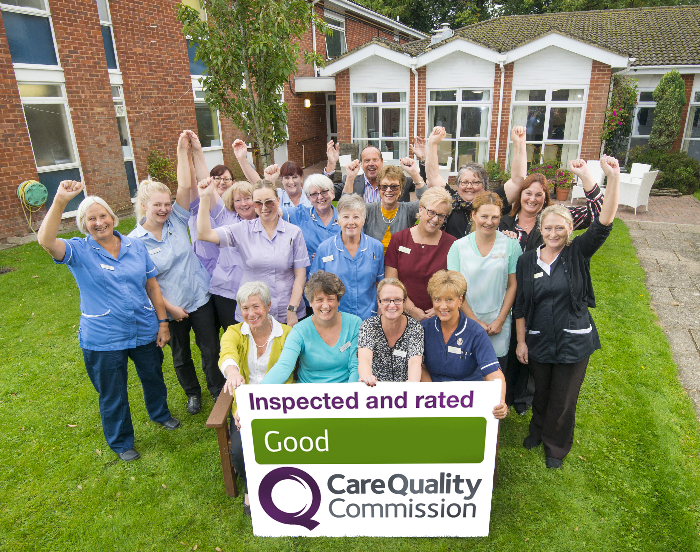 Management and staff celebrate the new CQC rating, in the gardens of Forest Oaks.Seated at the front are, left to right: Jo Husband (Chair of The Board of Trustees), Heather Fortnum (Registered Home Manager), Elaine Croal (Deputy Manager) and Lisa Froud (