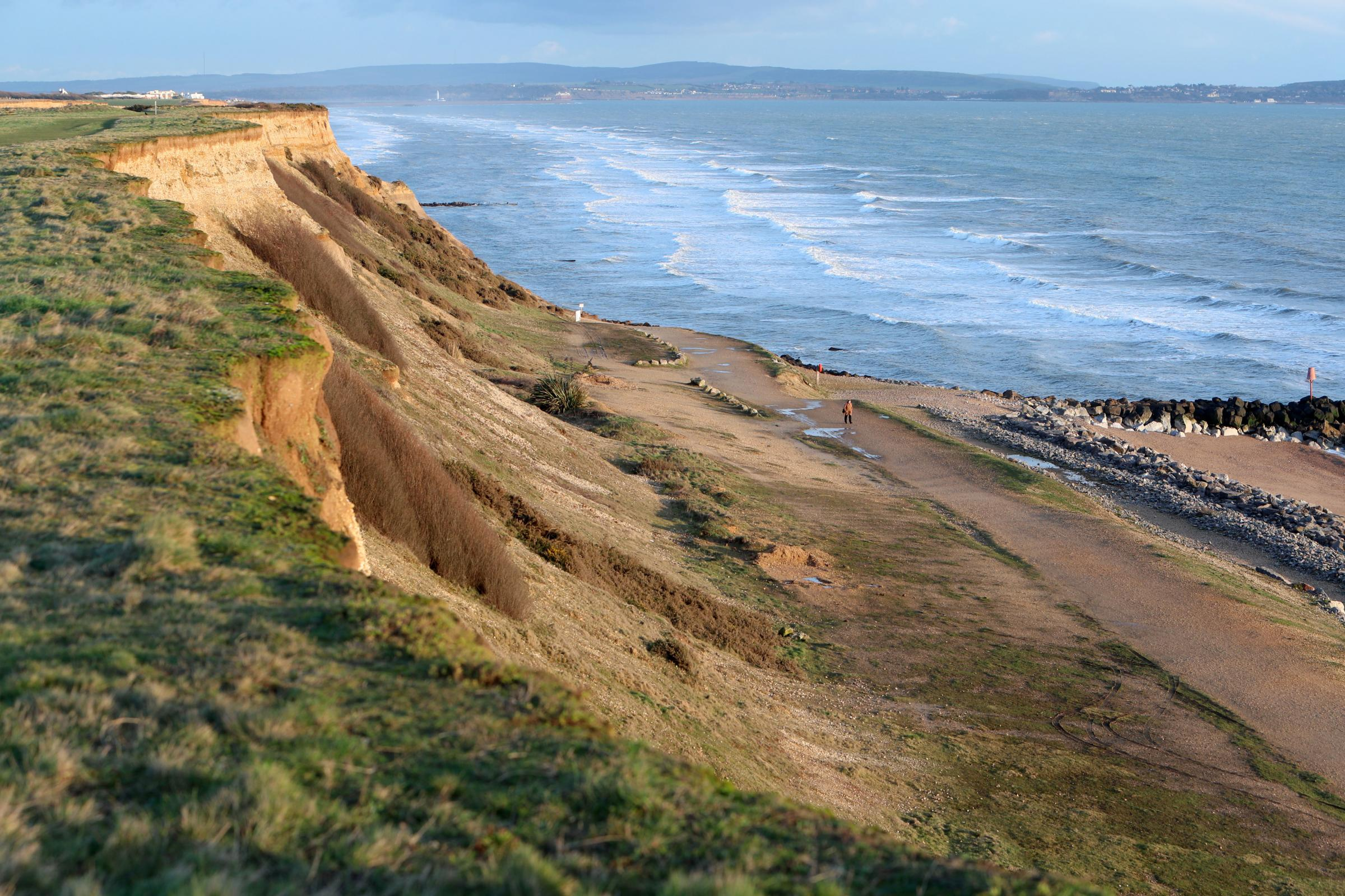 The cliffs at Barton-On-Sea including signs warning of unstable cliffs. ..