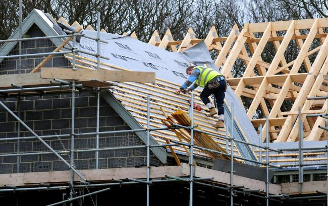 File photo dated 28/2/12 of a general view of roof workers building new houses in Derbyshire as a surge in housebuilding spurred a new wave of optimism in the construction sector as it achieved its best performance for three years, figures have showed. PR